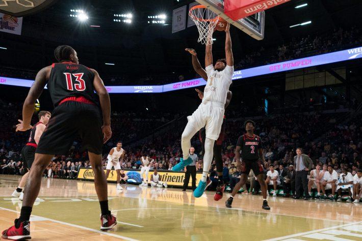 Georgia Tech Yellow JacketsJames Banks III  throws down a dunk versus the Louisville Cardinals