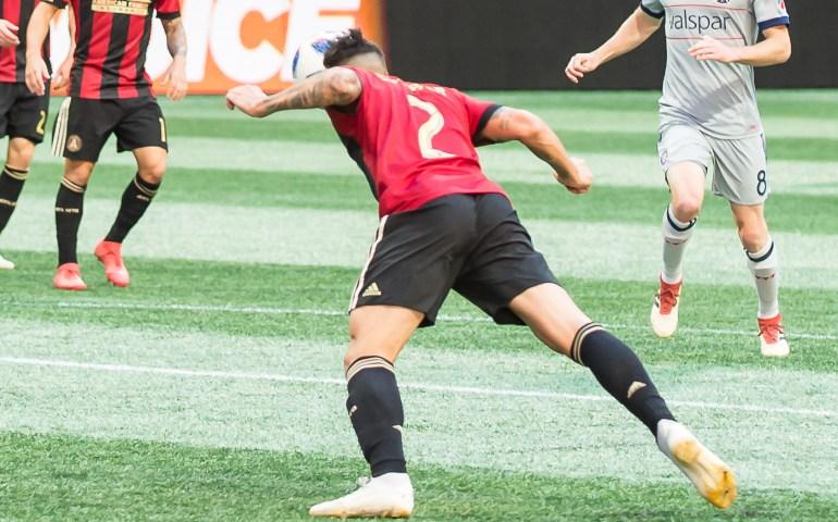 Franco Escbar uses his head to advance the ball