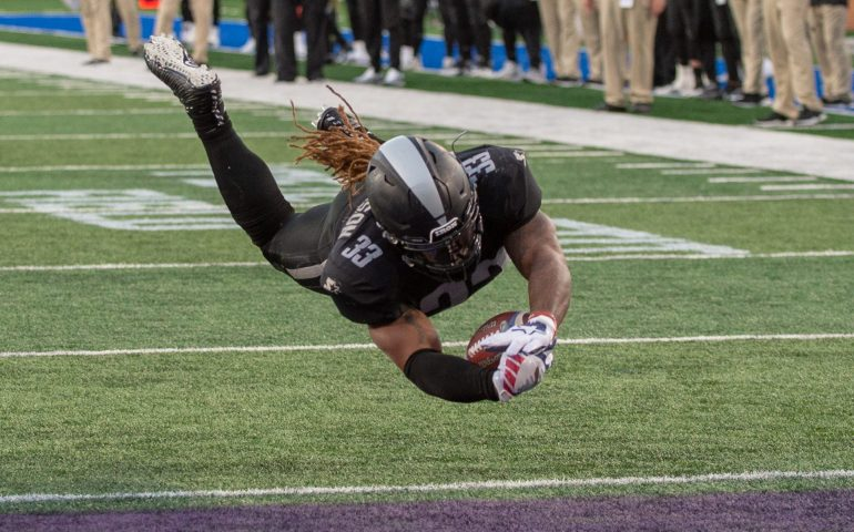Trent Richardson leaps into the endzone to score a touchdown versus the Atlanta Legends