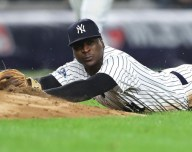 Didi Gregorius tasgs the base with all out effort