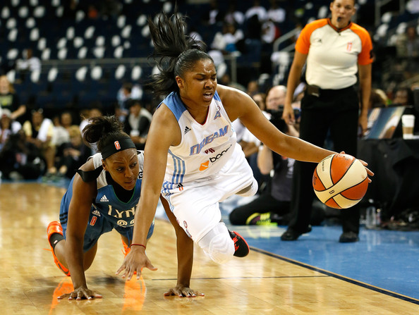 Alex Bentley of the Atlanta Dream hustling to the floor in an all out effort