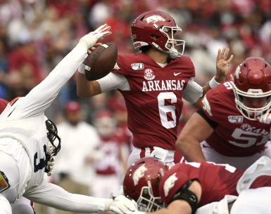 Marlon Davidson pressures QB Ben Hick for Arkansas in Auburn Football Action