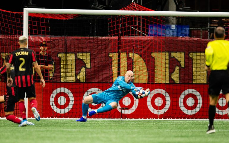 Brad Guzan makes a key save for Atlanta United against New england in the first round of the MLS playoffs