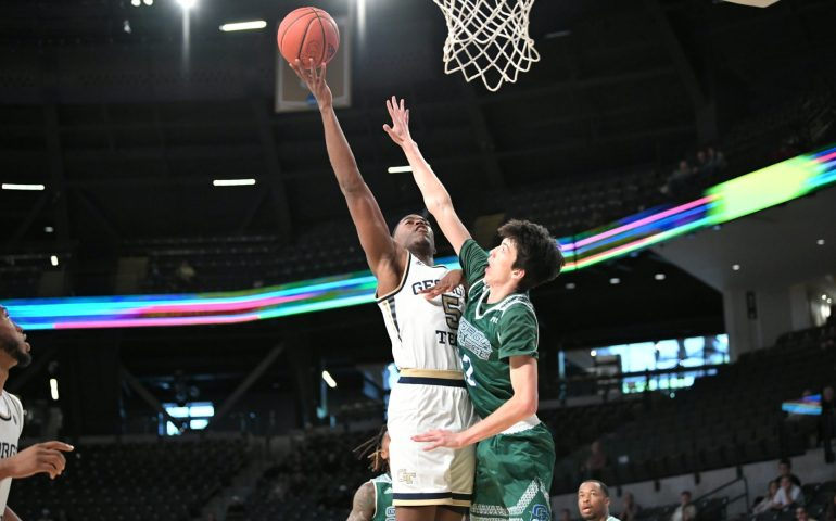 Moses Wright takes a shot during an exhibition game