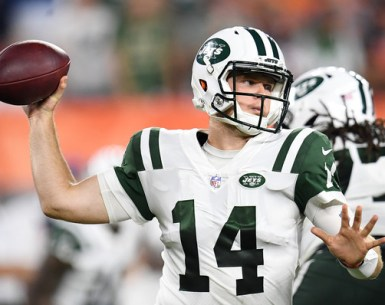 Sam Darnold throws a pass warming up for NFL Action