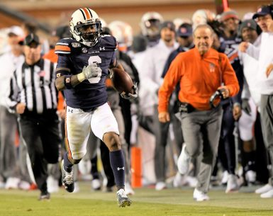 Christian Tutt returns the interception 57 yards against Ole Miss to preserve the victory