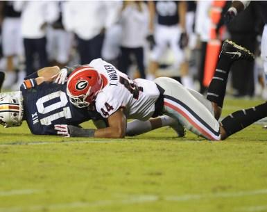Georgia Bulldogs Linebacker tackles Bo Nix to help send them to the SEC Championship Game