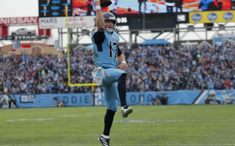 Ryan Tannehill celebrates after making a good play against the Houston Texans #titans, #Tennessee, #Texans,