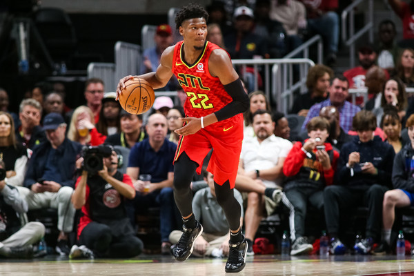Cam Reddish dribbles up the court for the Atlanta Hawks