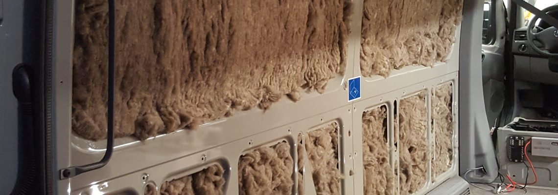 Why does Action Van insulate with sheep wool?