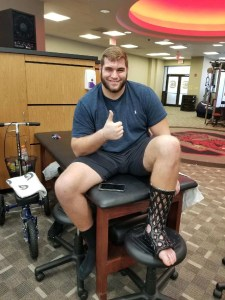 College Football Player sporting ActivArmor foot cast!