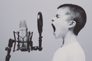 Kid yelling into microphone