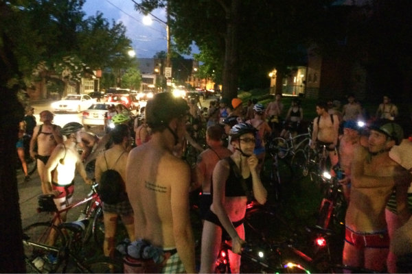 people ride through the streets of pittsburgh in their underwear