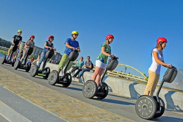a segway tour circles around the fountain at point state park