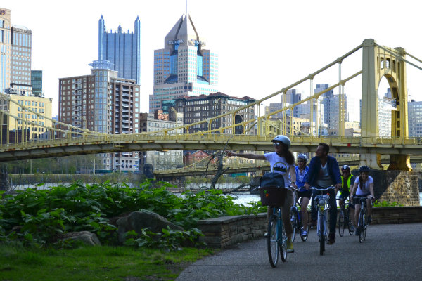 people take a guided bike tour in and around the city of pittsburgh pennsylvania