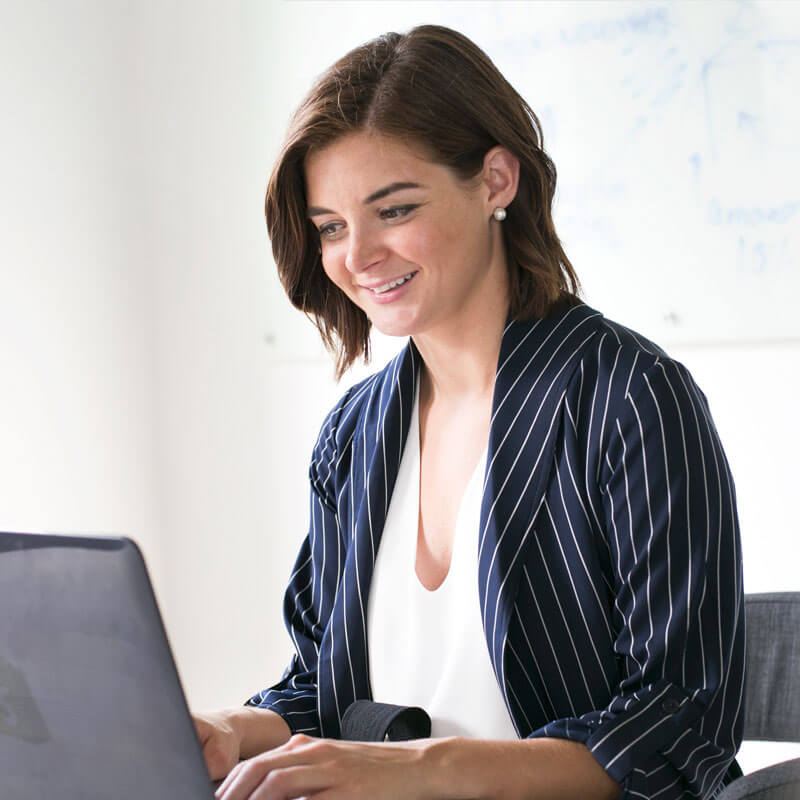 active media online website initial setup happy professional woman working on laptop