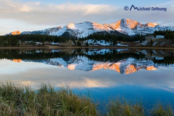 Little Molas Lake with recent snow on surrounding peaks, San Juan Mountains, Colorado on October 2, 2013, minutes before the setting sun.