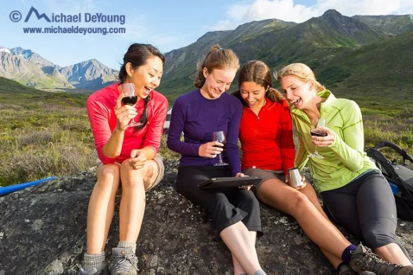 women camping with iPad