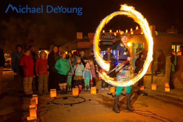 Melarie Roller performing at Bonfires on Bent Street holiday celebration in Taos, New Mexico