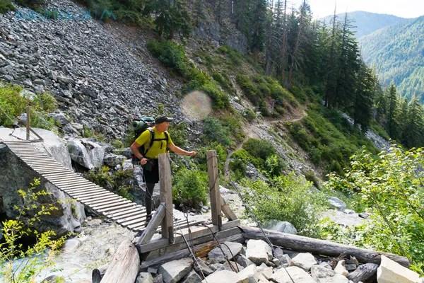 Self portrait walking over a suspension bridge in North Cascades NP on my way down Bridge Creek to Stehekin