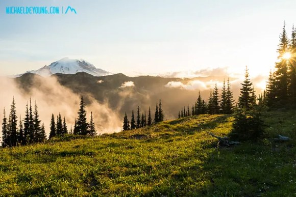 """Sunset and Mt. Rainier from Scout Pass on the PCT at 6500"""" with fog in valley below."""