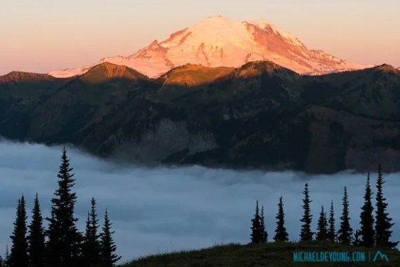"""Sunrise and Mt. Rainier from Scout Pass on the PCT at 6500"""" with fog in valley below.  Same vantage point as sunset image"""