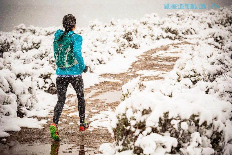 Winter trail runner on West Rim Trail. Taos, New Mexico