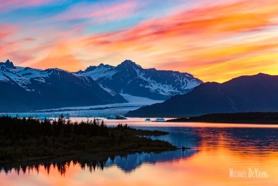 Cirrus clouds glow at sunset at Bear Glacier © Michael DeYoung