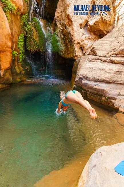 Woman plunging into the water below Elves Chasm - Grand Canyon National park