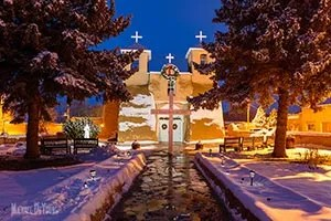 Winter reflections of San Francisco de Asis Mission Church - a historical church in Ranchos de Taos