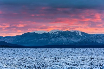Winter sunrise over snow covered sage