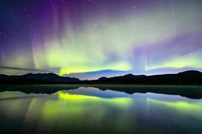 Northern Lights swirling above Alaska Range. © Michael DeYoung