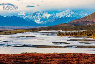 Fall tundra colors line the Susitna River with views of Mount Deborah and Hess. © Michael DeYoung