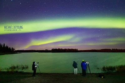 A group on a private tour takes in a fantastic aurora display near Fairbanks. © Michael DeYoung