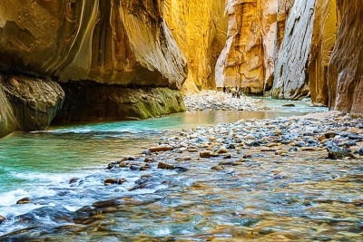 Virgin River flowing through towering Zion Canyon walls in the Narrows © Michael DeYoung