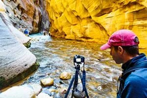 Photographer taking pictures in the Zion Narrows ©Michael DeYoung