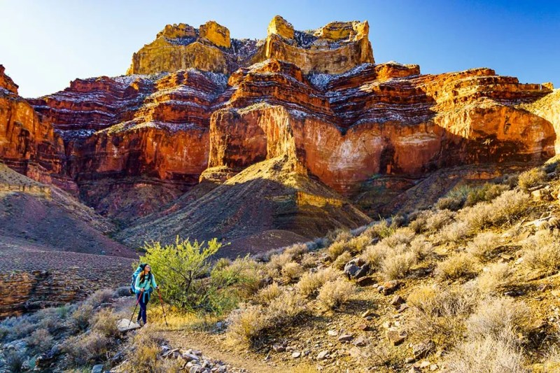 Woman hiking on the Tonto Trail west of Bright Angel Trail.  Grand Canyon National Park, Arizona. Photo © Michael DeYoung