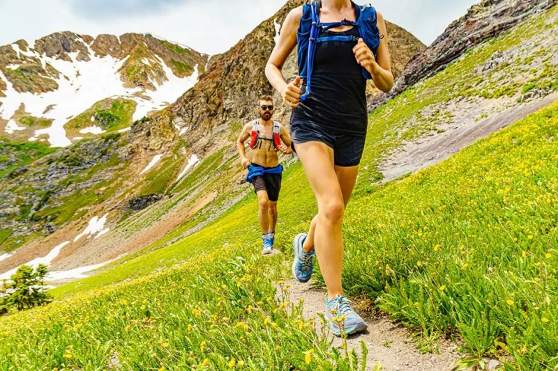 Couple trail runners in the Ruby Range alpine above Crested Butte, Colorado. Photo © Michael DeYoung