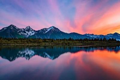 Reflection of pink sky on Bear Glacier Lake © Michael DeYoung