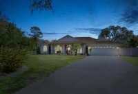 Fenced 1/2 Acre Home with Screened-in Patio & Pool