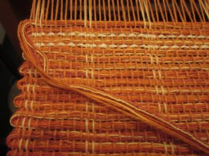 Multiple yarns in the weft