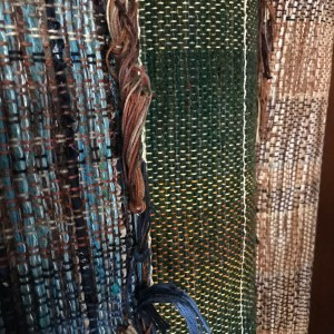 Bolts of handwoven fabric