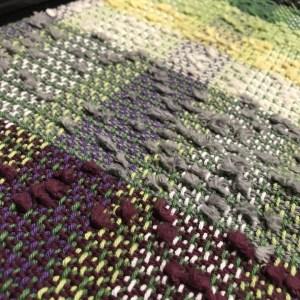 Handwoven fabric using yarn waste
