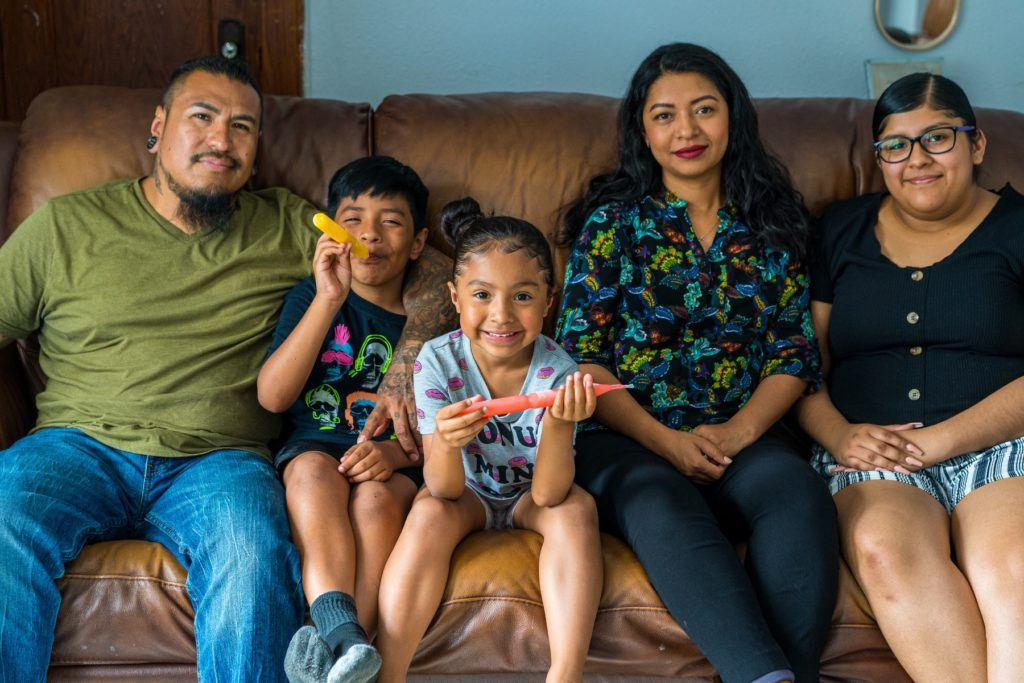 Acts homeowners Horacio and Maria with their family