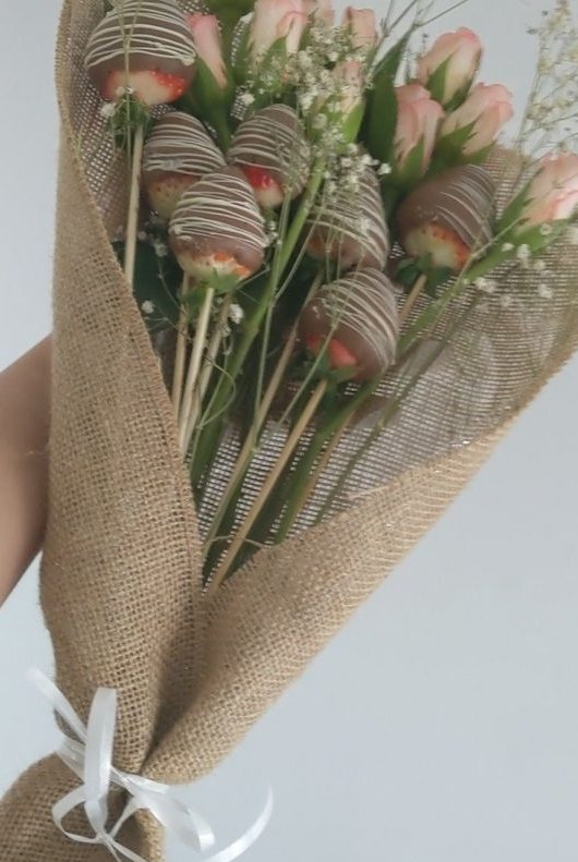Chocolate covered strawberry bouquet with fresh roses