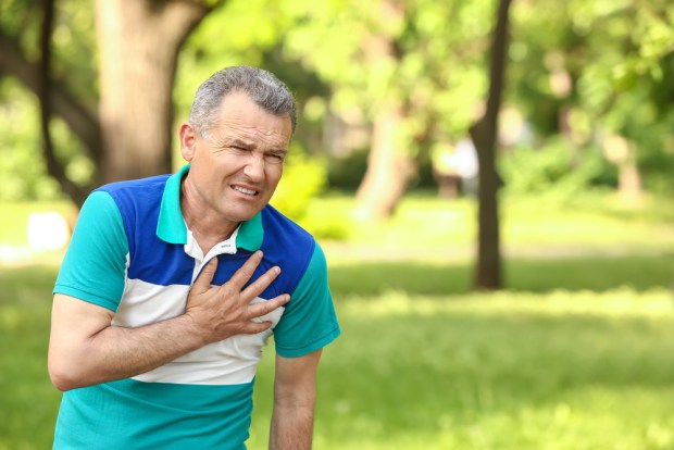 old man experiencing chest pain