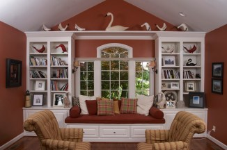 White bookcases and swans