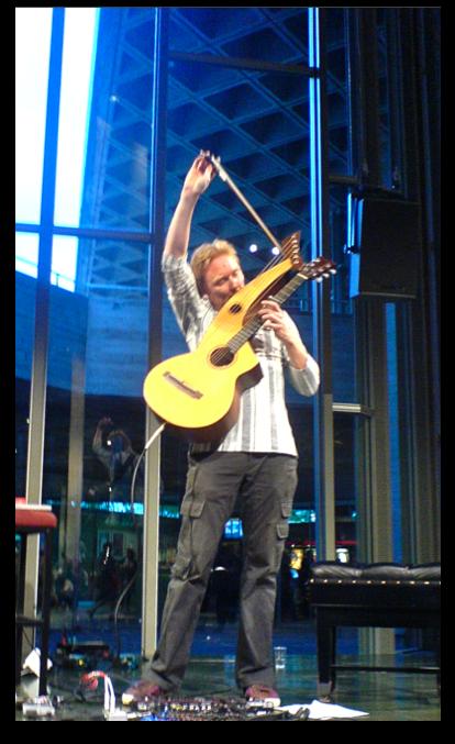 Jason Carter playing Harp guitar at national