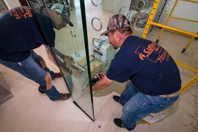 Eric and Chris Adjusting Custom Wine Cellar Suspended Wine Ring Rack