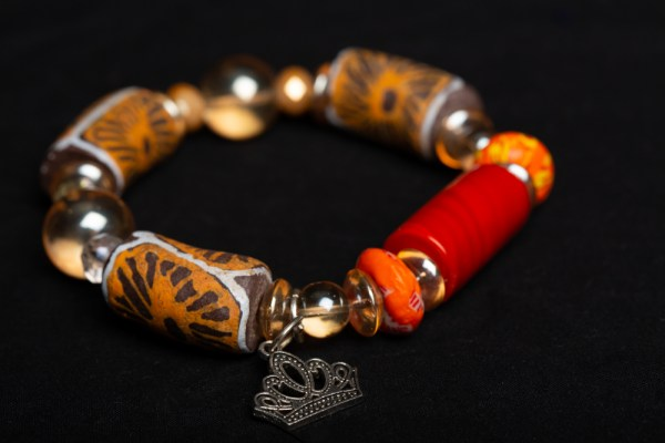 Clear, Orange and Tan with Large Red Bead and Crown Charm